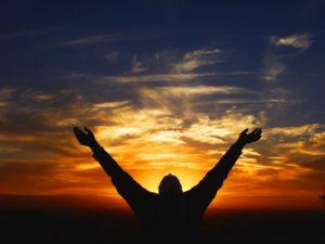men-raise-hands-to-worship-god