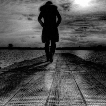 person-walking-in-desert-black-n-white-550x360